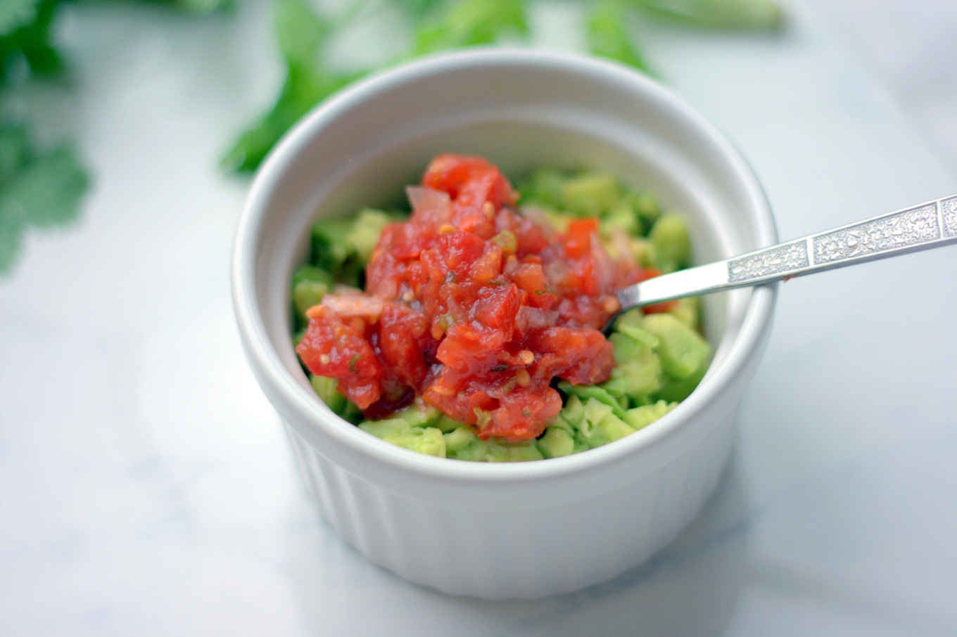 using salsa as a topping or mix-in for guacomole