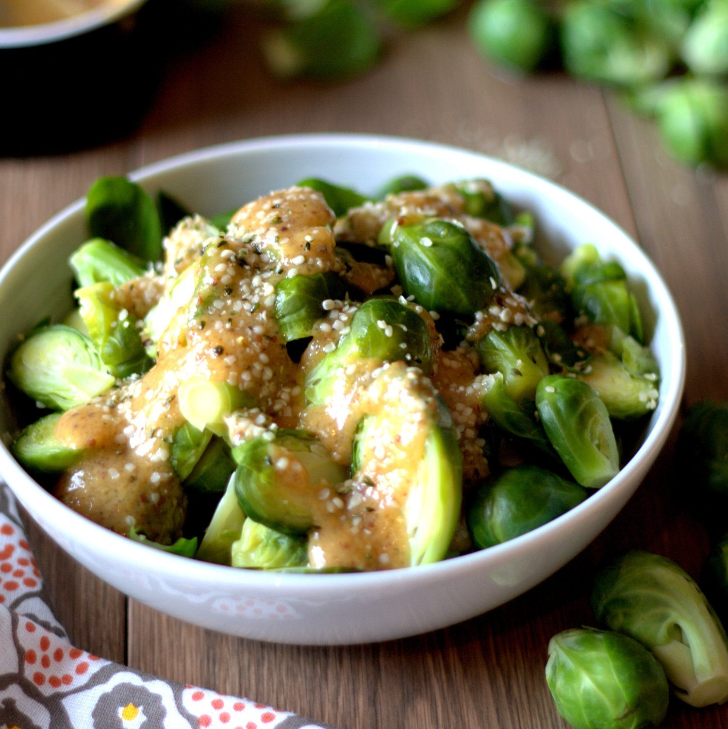 ginger miso dressing Brussels sprouts salad in a bowl