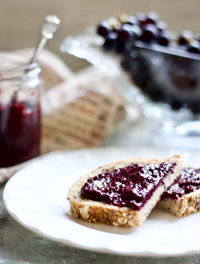 """Raw grape jelly is a great alternative to cooked ones preserving many of the heat-sensitive antioxidants and enzymes, let alone how much easier it is to whip up a batch. To be honest, I never have pectin stored in the pantry, so these chia seeds are life-savers on days I run out of jam. They thicken up fruit puree in no time while no cooking is required at all. I nicknamed the recipe """"instant jam"""" owing to the fact that I made this raw chia Concord grape jelly in under 5 minutes."""