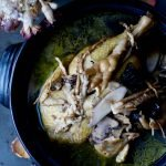 """PMS relief Chinese herbal chicken soup based on Traditional Chinese Medicine formula """"Si Wu Tang"""", cooked and served in a traditional clay soup pot."""