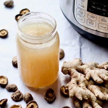 Instant Pot shiitake ginger chicken bone broth in a jar.
