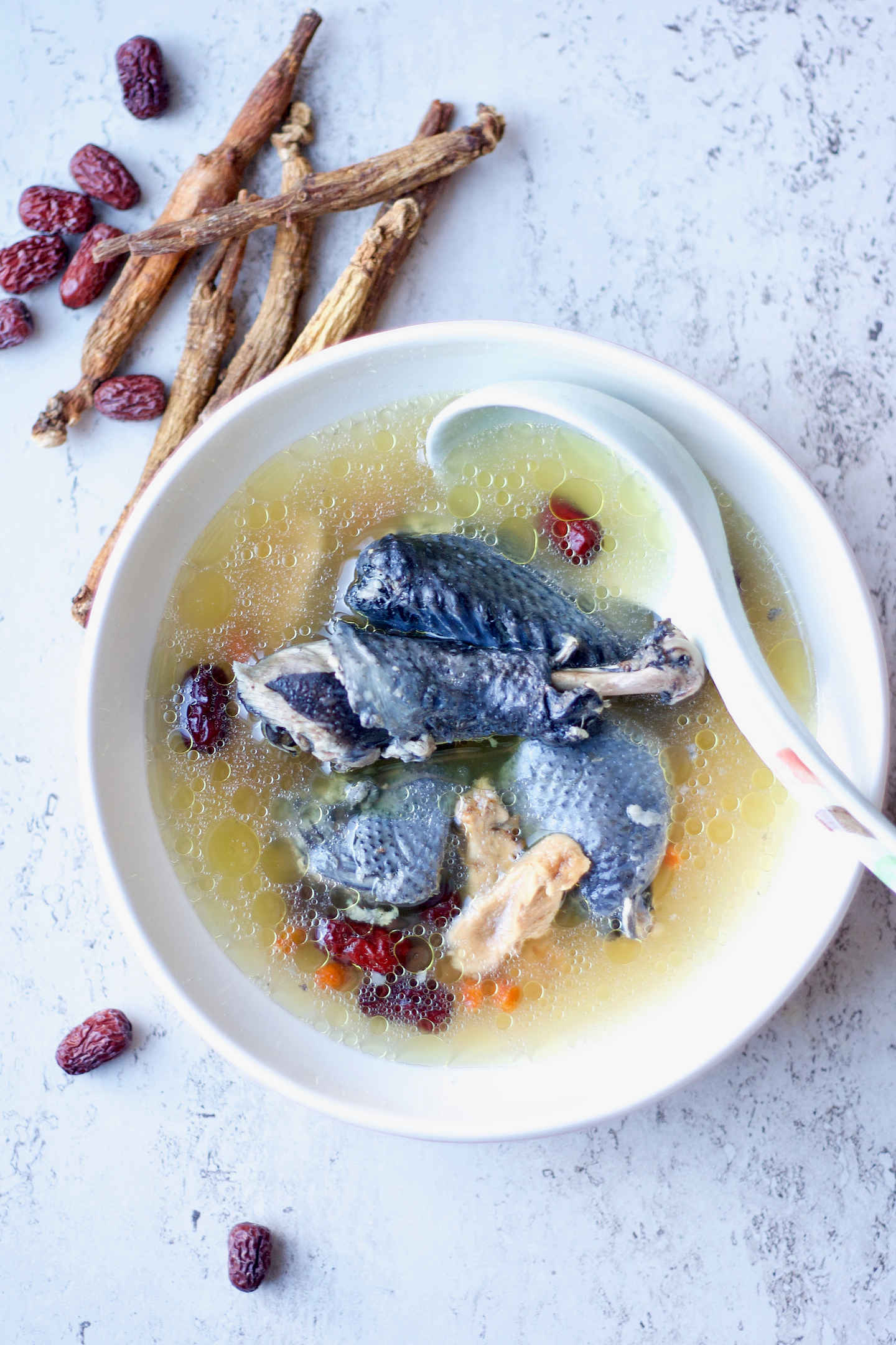 a bowl of silkie chicken in beautiful broth