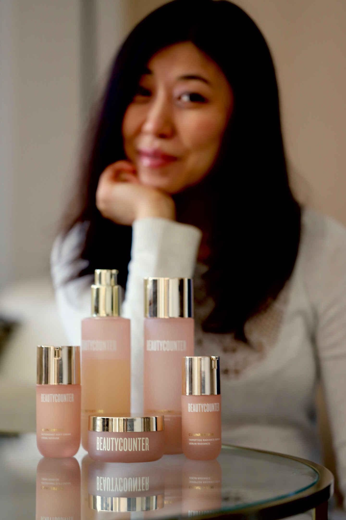 my Beautycounter countertime regimen set in pretty pink glass bottles