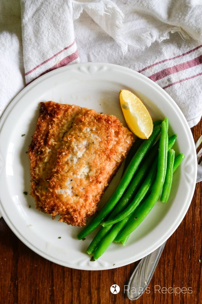 crispy keto coconut salmon served with green beans on the side