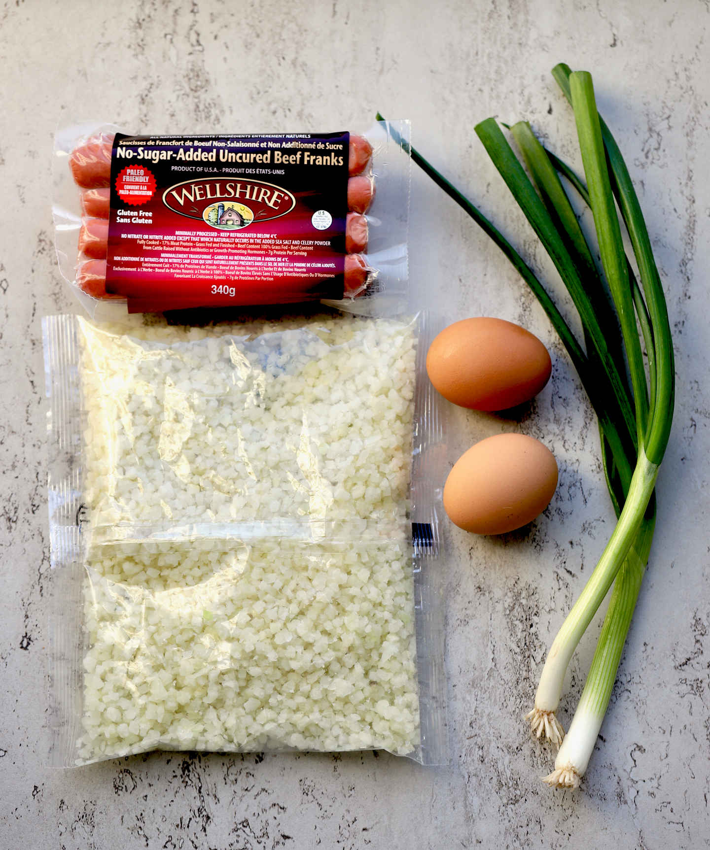 Ingredients for the recipe: frozen cauliflower rice, eggs, all natural sugar-free grass-fed franks, eggs, green onions
