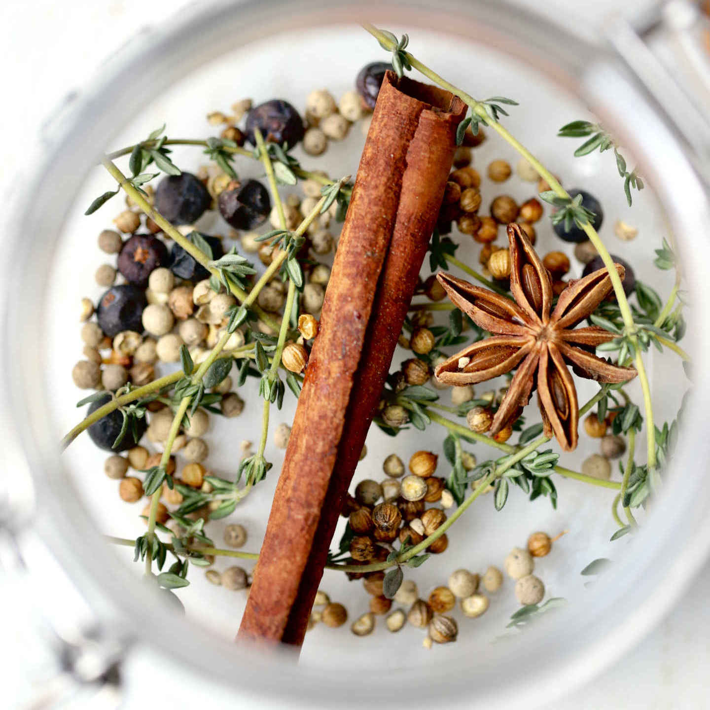 herbs and spices for the pickling brine: thyme, cinnamon stick, star anise, juniper berries, coriander seeds, white peppercorns