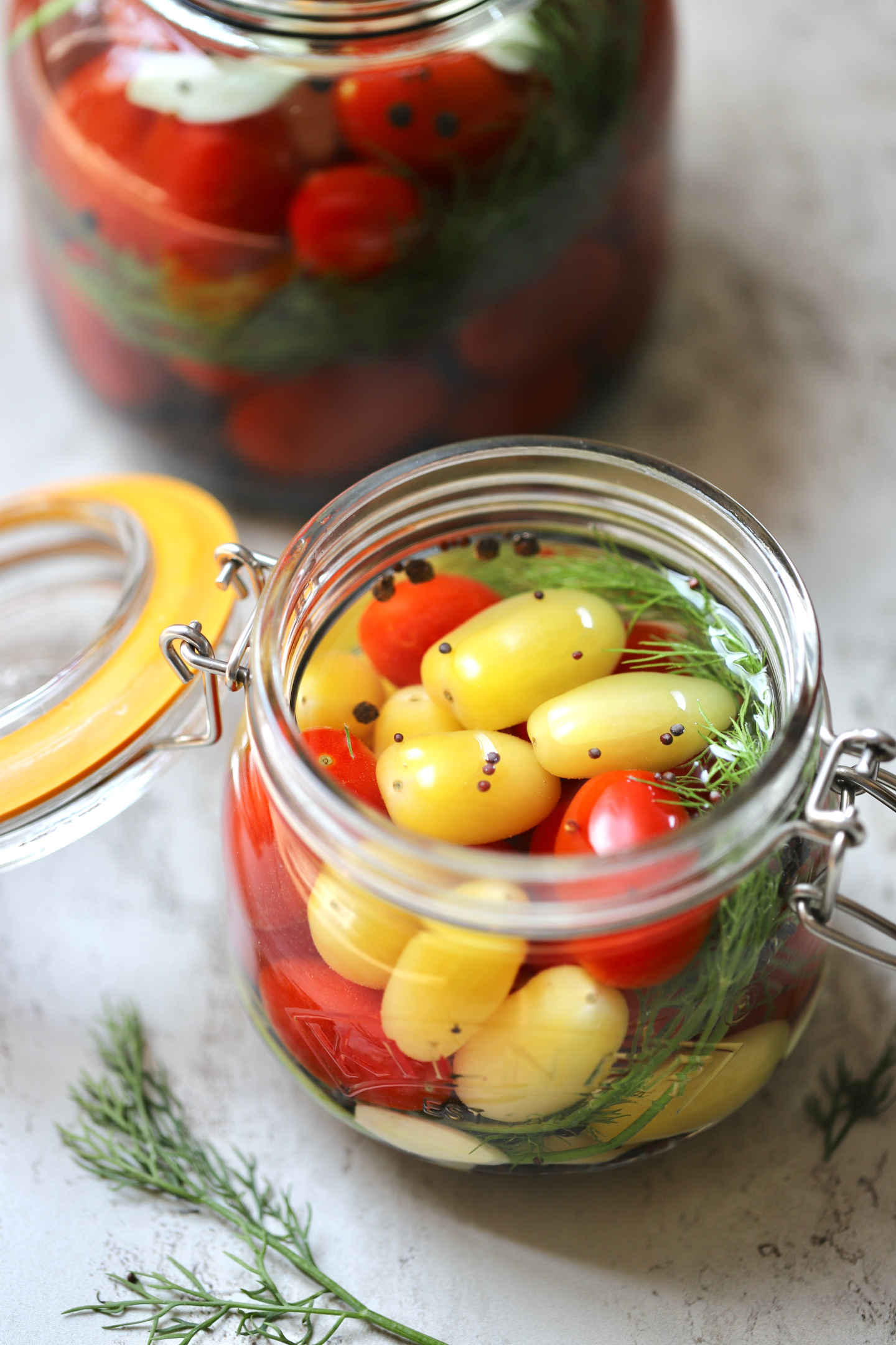 mixed red and yellow tomatoes in salt brine