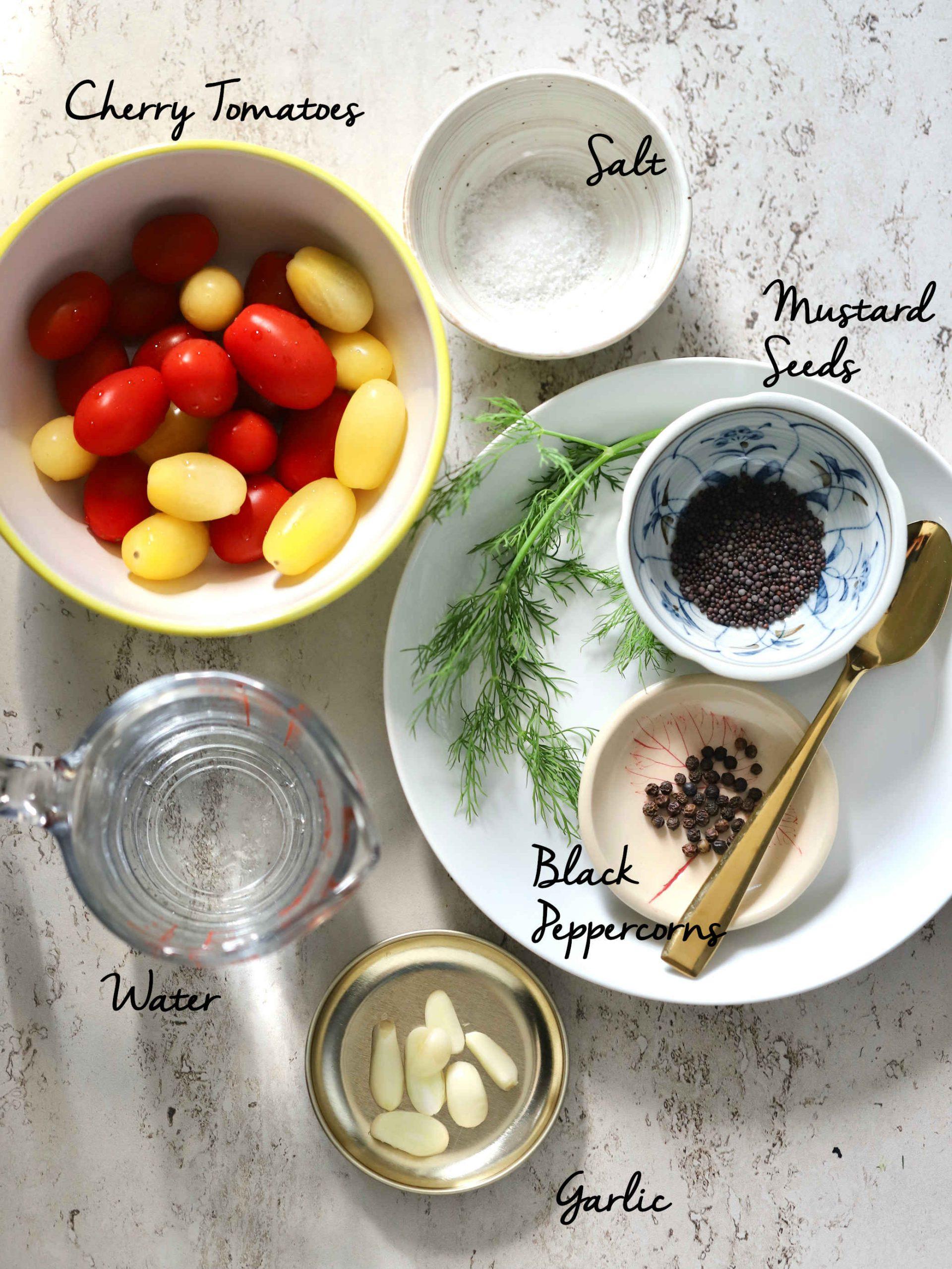ingredients for this recipe: cherry tomatoes, salt, mustard seeds, black peppercorns, water, garlic