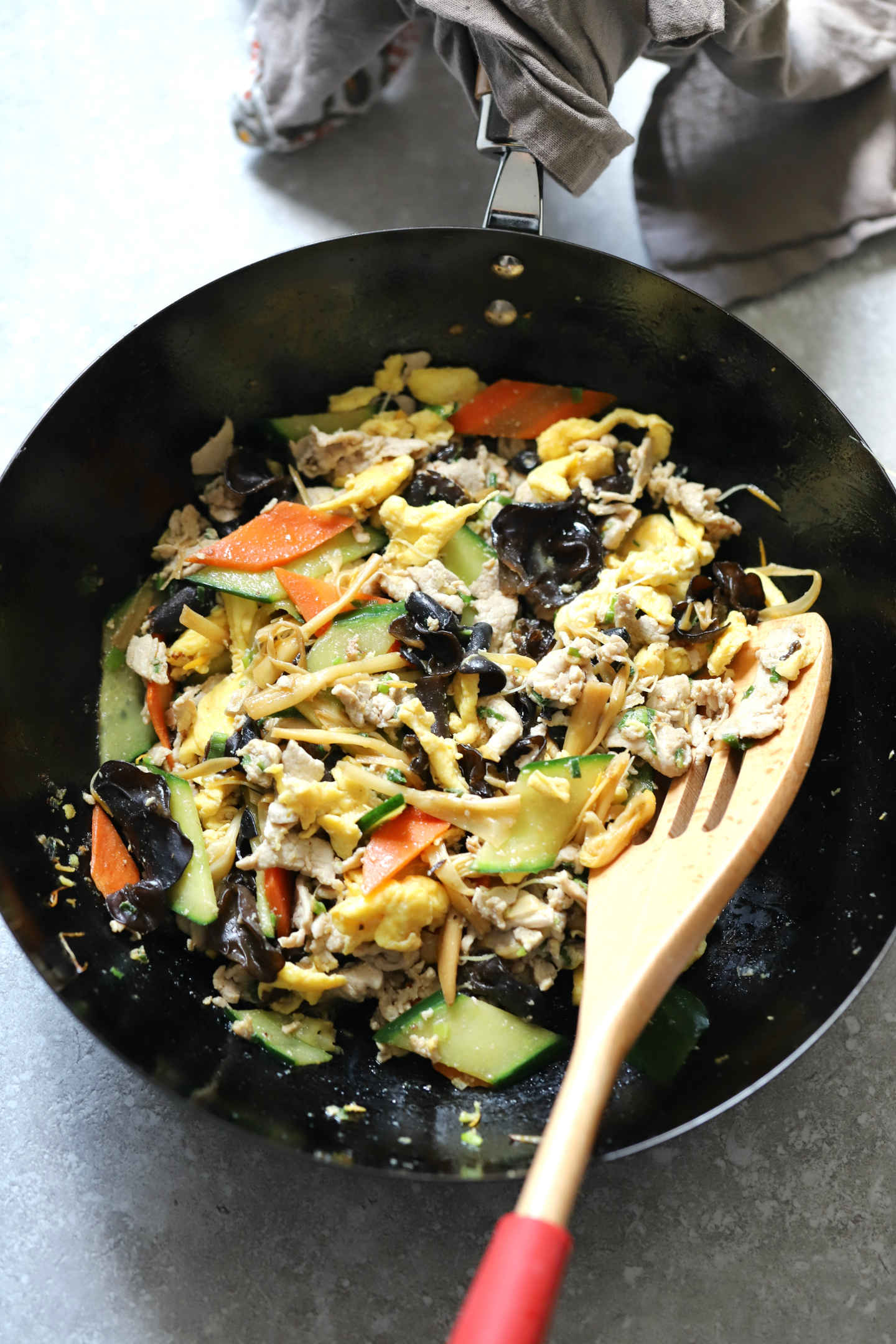 Moo Shu pork stir fry contains pork, eggs, wood ear mushrooms, lily flowers, cucumber and carrot