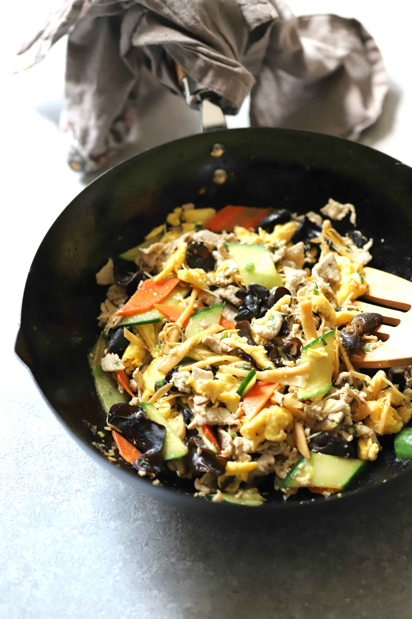 Moo Shu pork stir fry in a wok