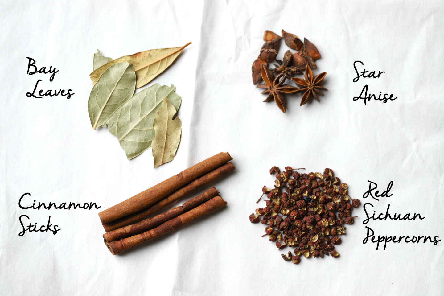 spices for the salt brine: bay leaves, star anise, cinnamon sticks, red Sichuan peppercorns