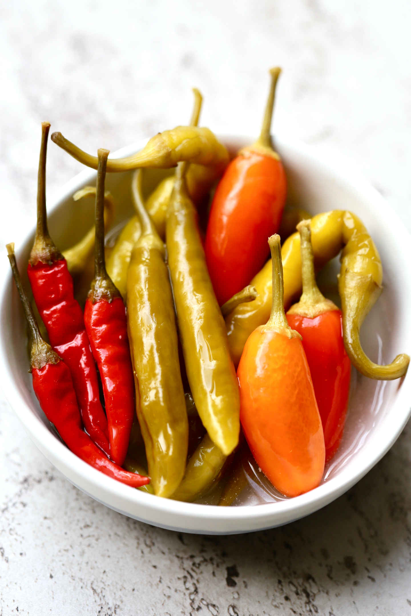 fermented tabasco peppers, bird's eye chilies, green cayenne peppers, and green Corno Di Capra peppers